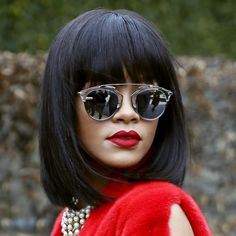 Mirrored sunnies, bob with bangs, bold red lips