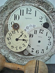 buy those ugly plastic clocks and break them apart and just keep the faces!