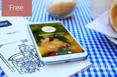 A free photorealistic free PSD Samsung Note 2 mobile mockup on table.