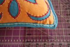 Freezer Paper Stenciled Reverse Applique Hand Stitched Pillow Tutorial