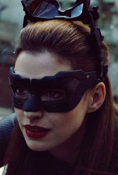 "Catwoman-Her ""ears"" are two pieces, eye protectors and night goggles that each fold down. Very handy!"