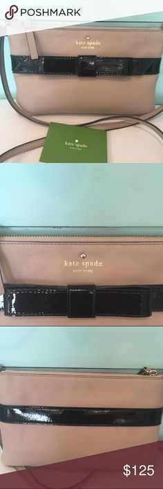 kate spade cross body bag Gorgeous beige leather bag. Patent leather black bow. Black and gray polka dot liner. Brand new with out price tag but has all new brochure about the leather and a dust bag. Measurement: 9x6x1 in. Perfect for a night out or a luncheon! kate spade Bags Crossbody Bags