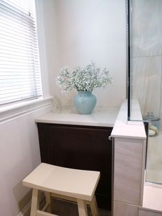 """Overall cost of bathroom, including gutting, new walls/ceiling, Congoleum floor tiles, tiled shower with ledge seat, Kohler toilet/faucets, StarMark cabinetry (cherry wood with Hazelnut stain), Vicostone quartz countertops in """"Taj Mahal"""", plumbing not moved:  $21,000. I have about $1,500 in the mirrors, towel racks, etc., from Rejuvenation.com. Sherwin Williams Steamed Milk walls, Cotton White trim.  Northern exposure windows.  Stool from Sturbridgeyankee.com."""
