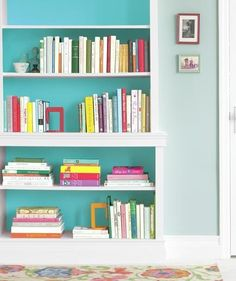 Do as the Pros Do Paint the back wall of a bookcase a hue that's a couple of shades deeper than the room color.