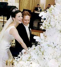 Michael Douglas & Catherine Zeta Jones cut the wedding cake.