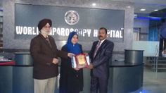 Dr. Fatimah BTE Mustafah receiving certificate of Fellowship in minimal access Surgery at World Laparoscopy Hospital. For more detail please log on to www.laparoscopyhospital.com