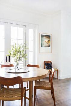 White framed glass doors, timber floor, simple moulded skirting