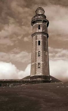 Capelinhos Lighthouse Azores ----- covered in ash by the year-long undersea volcanic eruption over 50 years ago which added an additional 2 square kilometers of land.