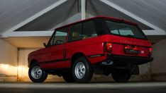 Range Rover. I miss my old 1976 two door Range Rover. In red just like this one...