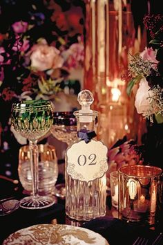 Using a crystal bottle for table numbers, creates a lavish look to winter weddings