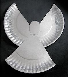 simple, plain paper plate angel - 1 paper plate, could use precut circles for the head, with a pre-punched hole in each wing to string yarn for hanging as an ornament.