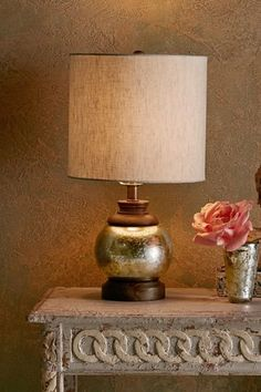With a mercury glass base, our Piedmont Table Lamp is crafted of dark mango wood and a linen drum shade.