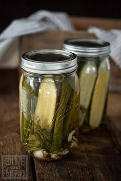 Quick Dill Pickles  2 lbs Pickling Cucumbers (a.k.a. Persian, Kirby) 3½ cups water 1½ cups white vinegar 1 tablespoon pickling salt 1 tablespoon white sugar 1 tablespoon white wine vinegar 6 cloves garlic 10-12 sprigs of fresh dill 2 24 oz Wide Mouth Ball jars with Lids ¼ teaspoon whole black peppercorns ¼ teaspoon red pepper flakes ⅛ teaspoon celery salt