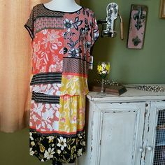 """Beautifully colored dress! NWT Style & CO dress from Macy's. This dress has peach, yellow, black, and white. It is an XL with an elastic waist band. It is 95% Polyester and 5% Spandex.  From the top to the waist is 20"""" long and from the waist to the bottom is 17"""" long. Style & Co Dresses"""
