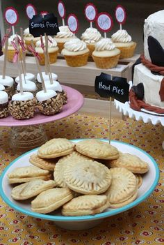 Dessert ideas: hand pies and s'mores pops (jumbo marshmallows, chocolate almond bark, and crushed graham crackers.)