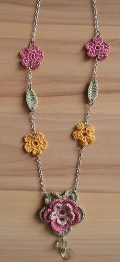 inspiration for a crochet flower necklace. She bought the flowers on etsy, but it shouldn't be too hard to find a pattern for similar ones. The chain is recycled from an old, never worn necklace. Cute!