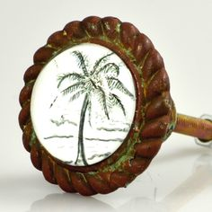 Island Living now within reach ! https://www.charlestonknobcompany.com/shop/antique-iron-w-glass-inlay-knob-palm-tree/