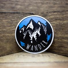"""Our Wander sticker, in a matte finish. This sticker is approximately 4"""" round."""