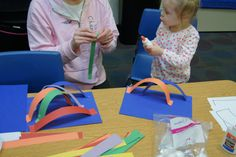 3-D rainbow with glue, strips of paper, and cotton balls. Good for learning about colors or weather theme