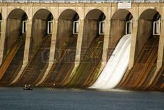 Water rushes through one of the flood gates at Wilson Dam in..