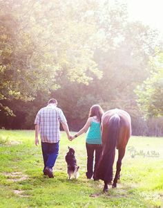 Family with horse and pup pose.
