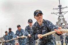 Sailors heave aboard mooring lines on the fantail of the guided-missile destroyer USS Laboon (DDG 58).