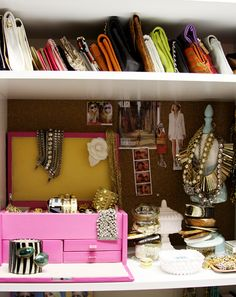 <3s: space for clutches and wallets + cork board + rings to hold bracelets + necklace mannequin = all great ideas!