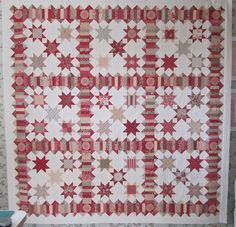 The pattern is 3 Barns by Miss Rosie's Quilt Co. The fabric is Rouenneries Deux and Chateau Rouge by French General for Moda