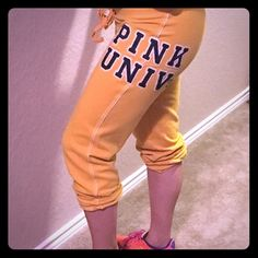 Victoria's Secret Pink Cropped Sweatpants When you wanna NetFlix and chill, but you wanna look cute! Grab these Victoria's Secret Pink cropped sweats for a cute and cozy look.  These have been loved, but still have so much life in them! Beautiful appliqué detail on left upper left side of leg and spunky yellow color. Happy shopping! PINK Victoria's Secret Pants Track Pants & Joggers