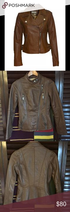 Michael Kors Brown Leather Moto Jacket MICHAEL KORS. Used but in great condition with minor scuffing in non-noticeable areas.  Gorgeous chocolate brown motorcycle style jacket. Product shot is for color ref.  I've worn this a fair amount over the years but haven't worn it for at least 2 years. It has years of life left!  Size is XS.  I regularly where size S. For reference my measurements are 34 Bust and 28 Waist. This jacket fits like a glove but is a bit too tight in the shoulders/upper…