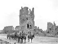 Australian artillerymen passing the ruins of the Lakenhalle (Cloth Hall), Ypres, September 1917 [AWM E00717]