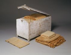 Gable-topped chest and linens, New Kingdom, Dynasty 18, 1550–1295 B.C. Egyptian; From the tomb of Hatnofer and Ramose, western Thebes Whitewashed wood; linen