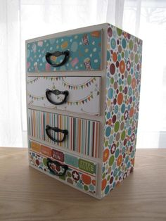 use coordinating scrapbook paper, mod podge to the drawer faces.