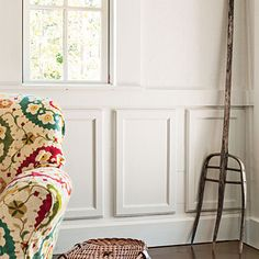 Make Wainscoting from discarded cabinet doors.  This space is pretty cool in general.