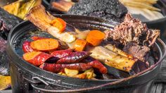 A selection of Chef Tim Byres' barbacoa fixings rests on top of a Dutch oven at Chicken Scratch.