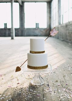 Give your cake a lovestruck look with this hand-painted and glittered decorative arrow.