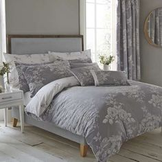 Detailed with a jacquard design, our charcoal grey and white reversible duvet cover features a rose pattern in a choice of two colourways and is available in a ...