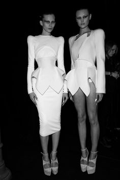 Sculptural fashion construction with an exaggerated silhouette; futuristic tailoring // Mugler