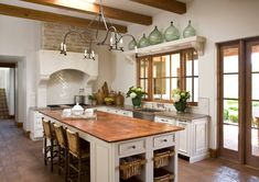 This gallery showcases beautiful designs of Spanish style kitchen ideas. Pictures feature cabinets, flooring and tile from Spanish kitchen designs. Hacienda Kitchen, Farmhouse Kitchen Decor, Decorating Kitchen, Farmhouse Table, Rustic Farmhouse, Decorating Ideas, Copper Kitchen, New Kitchen, Kitchen White