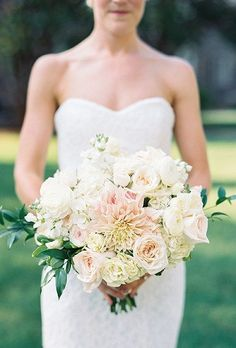 A pale pink and white bouquet comprises of dahlias, hydrangea, roses, and greenery, created by Tre Bella Inc.