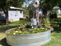 Use an above-ground container for your garden pond!....  See more at the picture