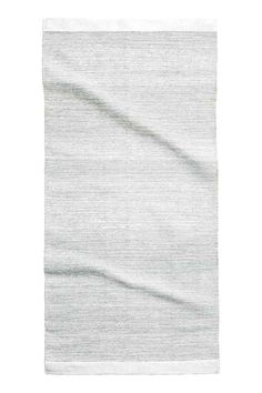 Glittery cotton rug: Rectangular rug in a cotton weave containing glittery…