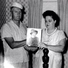 Gladys holding a picture of Elvis as a child with Vernon.