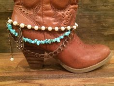 Glam up those cowgirl boots, ladies! This item features complimentary shades of bronze, pearl and turquoise.    Measures: 14.5 with a 2.5 extender