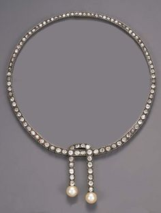 An antique diamond lavaliere necklace, by Mellerio dits Meller. Designed as a graduated old-cut diamond line with central two line diamond and (later) cultured pearl pendants, mounted in silver and gold, circa 1890, 37.2 cm. long, with red leather fitted case stamped Mellerio dits Meller, 9 Rue de la Paix and initials B.C. with coronet to the cover Stamped Mellerio, Paix. #Mellerio #Meller #antique #lavaliere #necklace