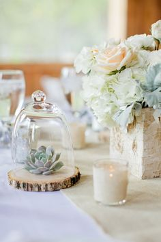 Light and airy meets rustic for this blush and grey tablescape. #wedding #centerpiece #terrarium