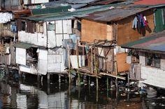 Photo about Squatter homes in the Philippines - shacks in shanty town along heavily polluted Paranaque river in Manila. Image of poverty, decay, community - 18795733 Philippines, Air Ride, Graphic Design Inspiration, Design Ideas, Booth Design, Squats, Stock Photos, Homes, Inspirational