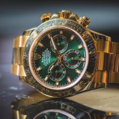 Undeniably Rolex, the gold & green dial Cosmograph Daytona.
