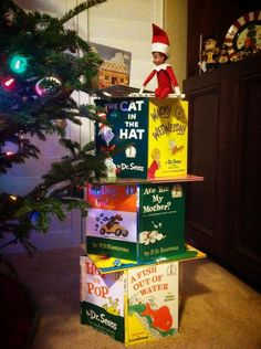 Meet Scout, our Sneaky Sneaky Elf! - Scout created his own House of Books while reading the Gingerbread House up top.