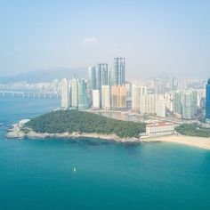 """I'll call this """"Haze Day"""" for posting. Continuing on with my post from earlier today from the North Korea/South Korea (DMZ) border this shot was taken from my DJI Mavic Pro at Haeundae Beach in Busan South Korea. 220 Miles (350km) south of Seoul. The haze is still paramount. We learned two things about the weather & air during our time in South Korea. We were told the country gets about 60 days of clear air per year and that on a clear day you can see Japan from Busan . Thirdly... the second…"""